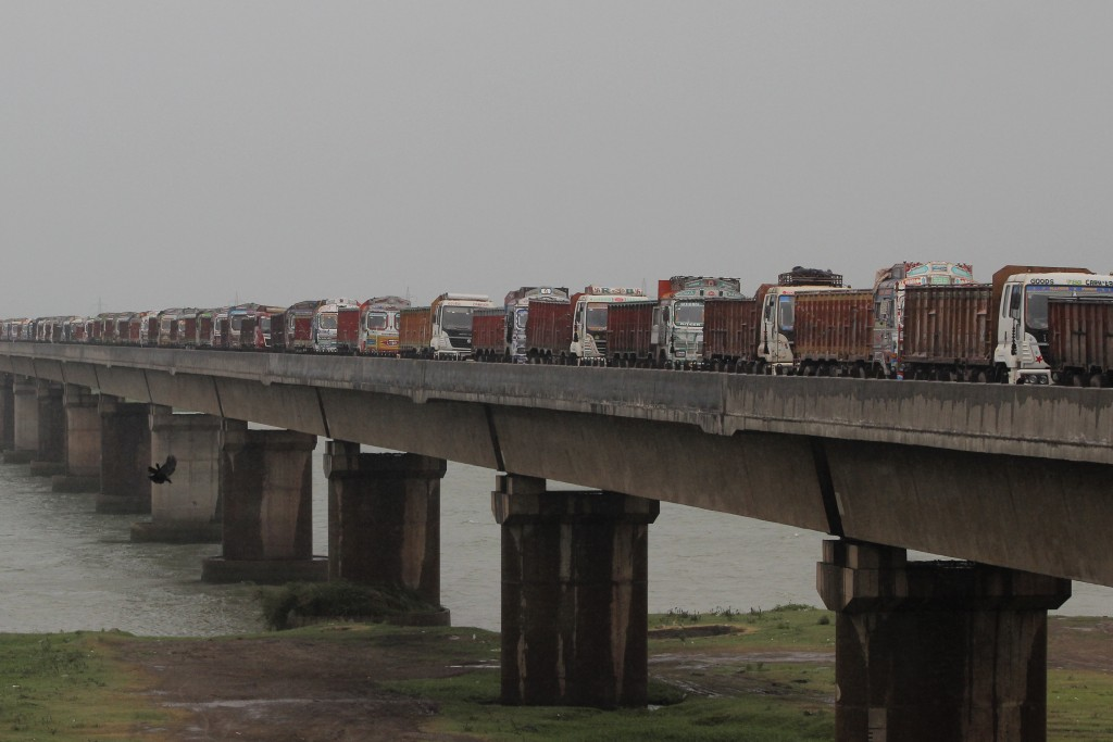 Trucks are stranded on a bridge across River Mahanadi at Paradeep, on the Bay of Bengal coast in Orissa, India, Tuesday, May 19, 2020. Cyclone Amphan ...