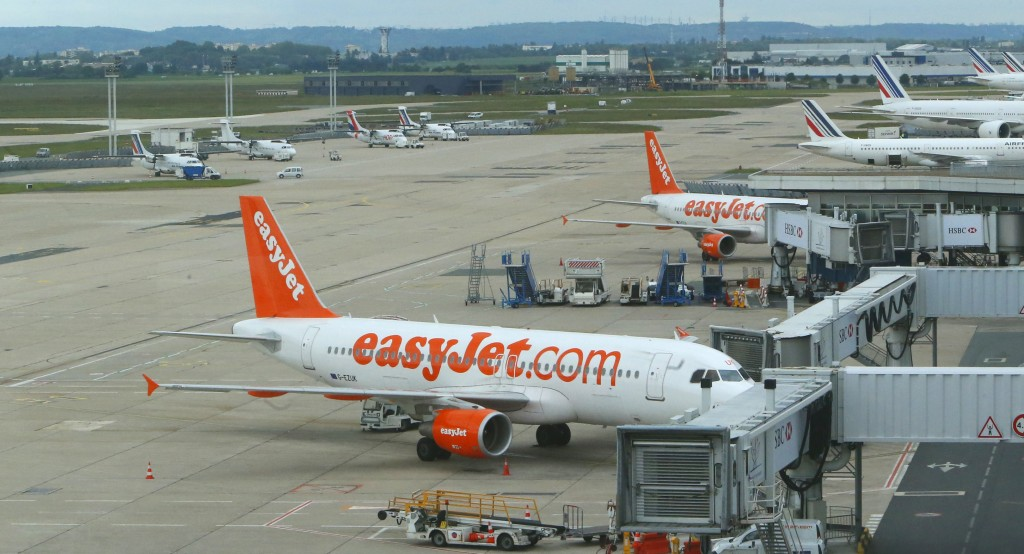 FILE - In this file photo dated Tuesday, June 11, 2013, Easyjet passenger jets on the tarmac at Orly airport, west of Paris, France.  The U.K.-based b...