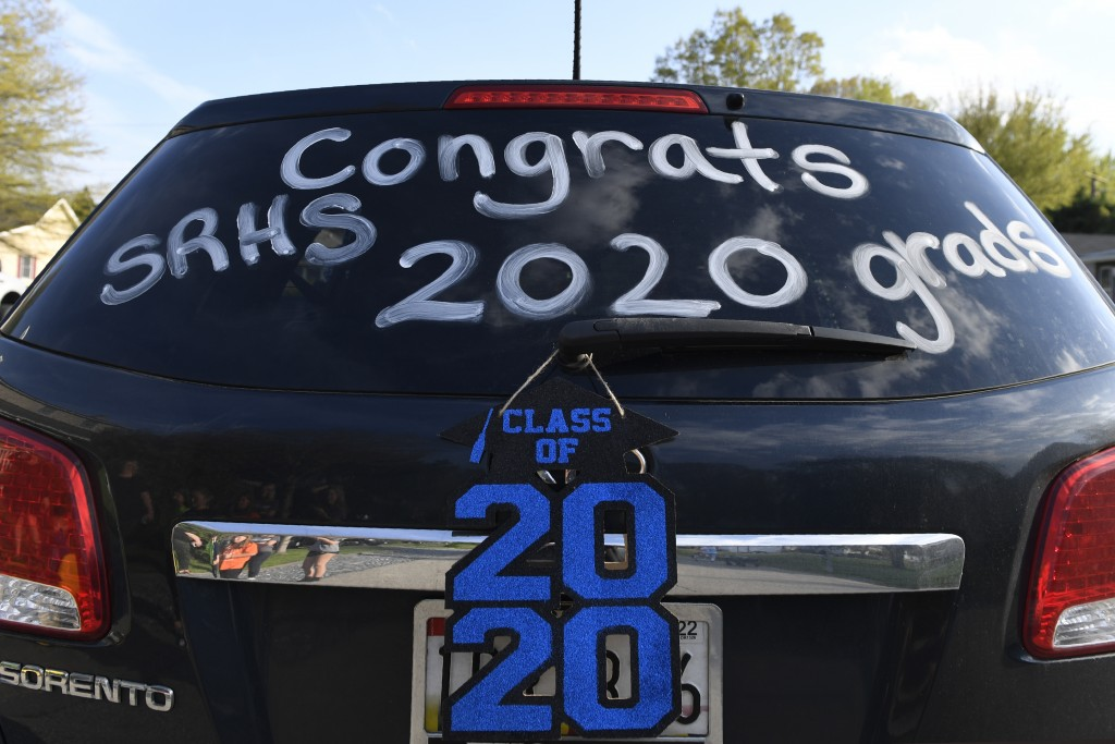 A car is decorated to celebrate the South River High School Class of 2020 during a family parade in Edgewater, Md., Monday, April 20, 2020. Many of th...