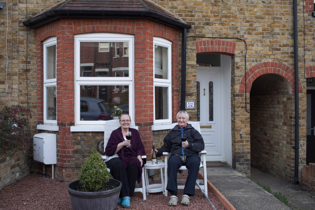Theresa and Bill Dallender enjoy an impromptu concert from their neighbor across the street, Clare O'Connell, a concert cello player and her husband D...