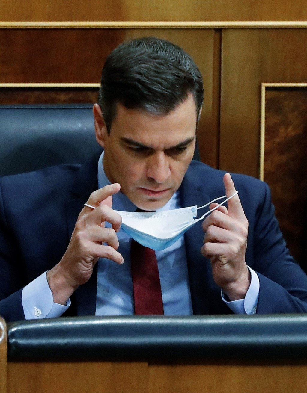 Spain's Prime Minister Pedro Sanchez sits in the Spanish parliament with a protective face mask in Madrid, Spain, Wednesday May 20, 2020. Sanchez is a...