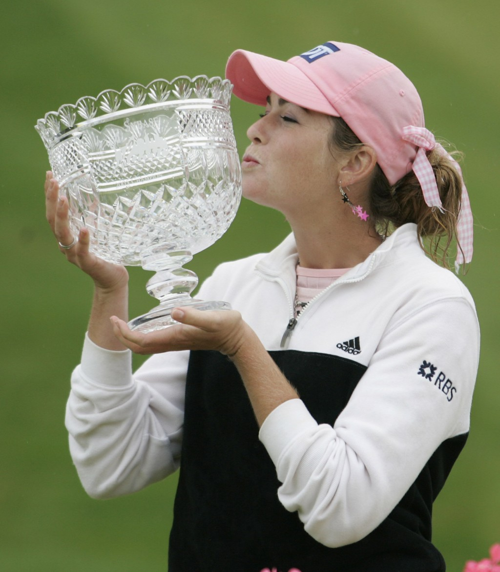 FILE - In this May 22, 2005, file photo, Paula Creamer kisses the trophy after winning the LPGA Sybase Classic in New Rochelle, N.Y. It was 15 years a...