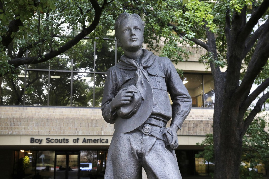 FILE - In this Feb. 12, 2020, photo, a statue stands outside the Boy Scouts of America headquarters in Irving, Texas. Nine sex-abuse lawsuits were fil...