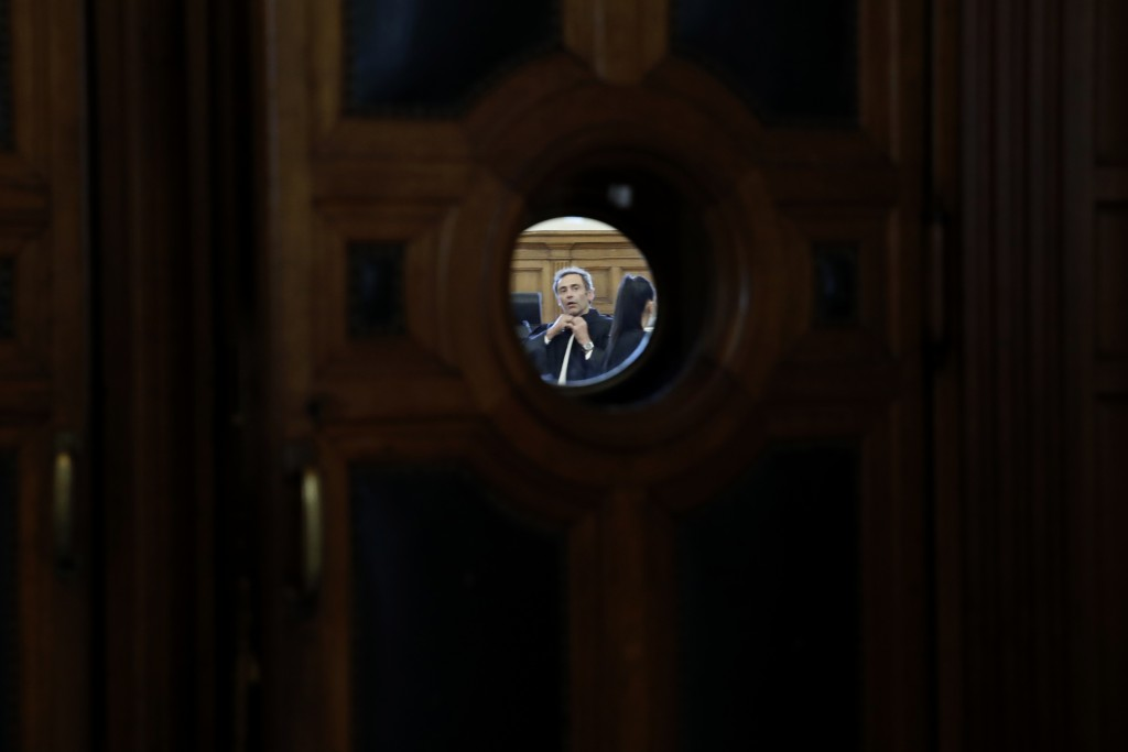 Laurent Bayon, one of Felicien Kabuga's French lawyers, wears a mask in the courtroom Wednesday, May 20, 2020 in Paris. Felicien Kabuga, one of the mo...