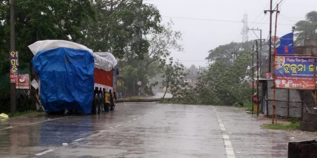 Trees lie uprooted on a highway from heavy winds ahead of Cyclone Amphan landfall, at Chandbali on the Bay of Bengal coast in Orissa, India, Wednesday...