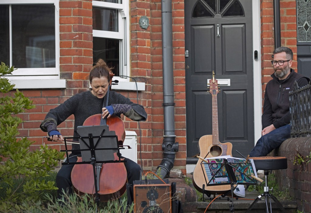 Clare O'Connell, a Concert cellist and her husband Dom Shovelton, a composer, offer an impromptu concert from their front door as neighbors flocked to...