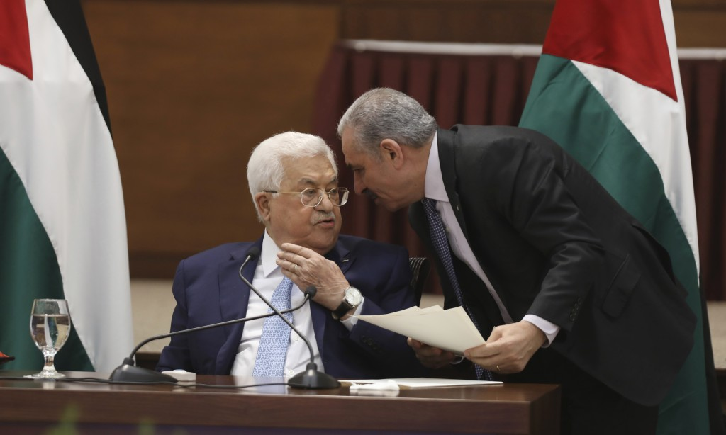 Palestinian President Mahmoud Abbas, left, heads a leadership meeting at his headquarters, in the West Bank city of Ramallah, Tuesday, May 19, 2020. (...