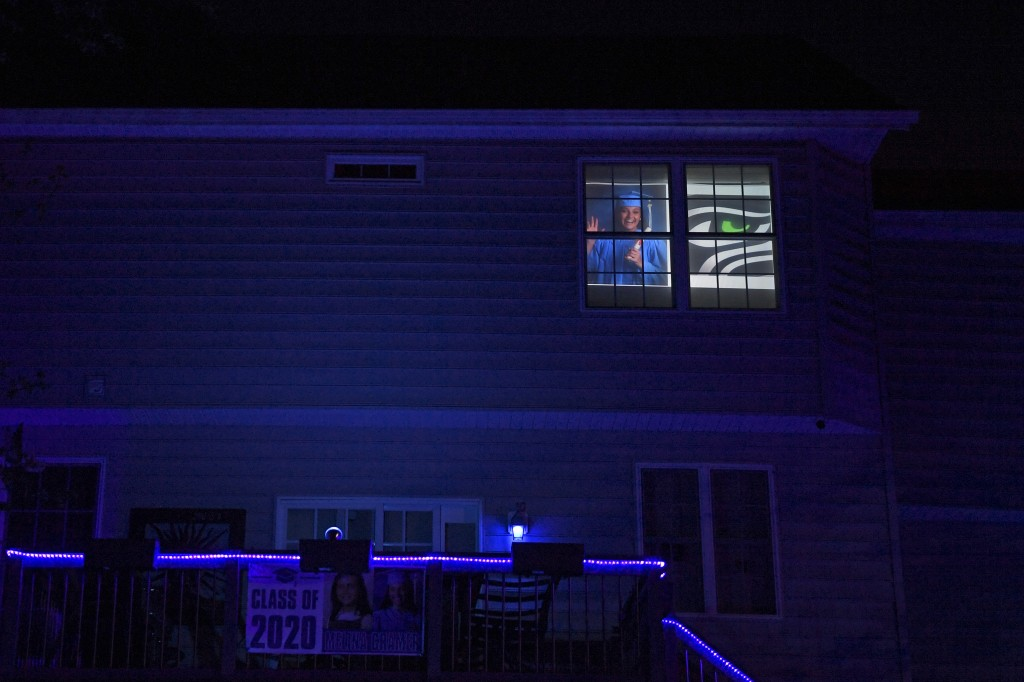 A photo of South River High School Class of 2020 senior Melina Cramer is displayed in the window of her home in Edgewater, Md., Tuesday, April 21, 202...