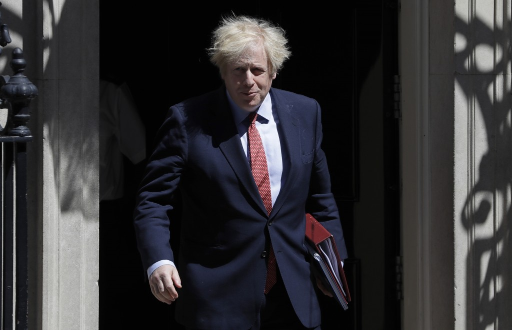 Britain's Prime Minister Boris Johnson leaves Downing Street to attend the weekly session of PMQs in Parliament in London as the country continues its...