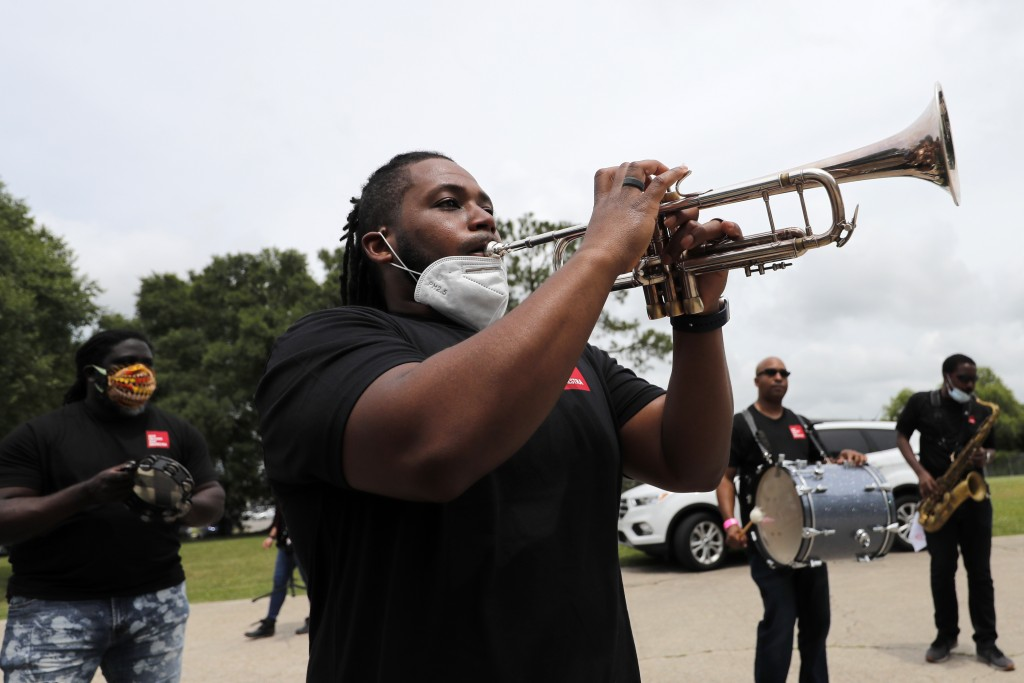 Members of the New Orleans Jazz Orchestra serenade healthcare workers at New Orleans East Hospital, as a tribute for their care of COVID-19 patients, ...