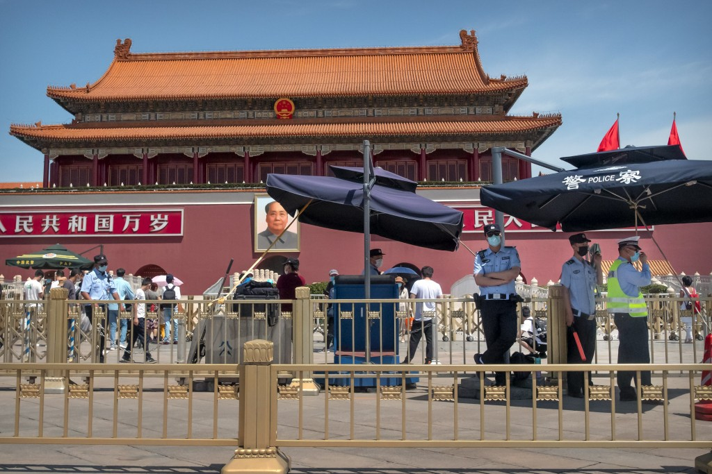 In this Wednesday, May 20, 2020, photo, Chinese police stand guard in front of Tiananmen Gate in Beijing. This year's version of China's biggest polit...