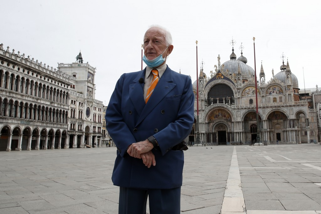 FILE - In this Wednesday, May 13, 2020 file photo, Arrigo Cipriani, owner of Harry's Bar, talks with The Associated Press in St. Mark's Square in Veni...
