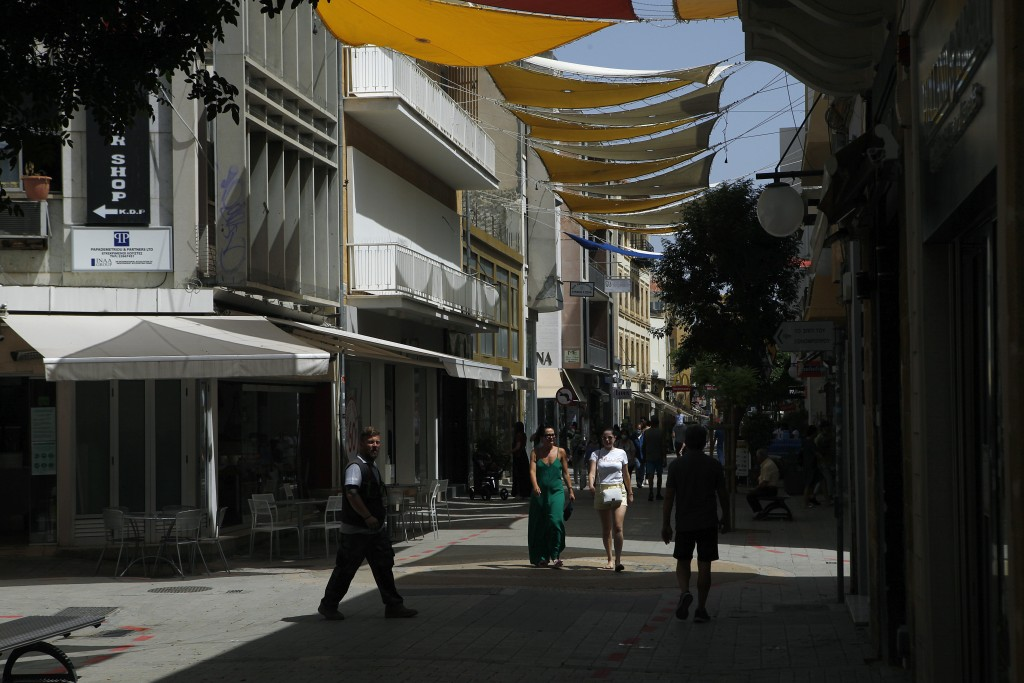 People walk on Ledra street a main shopping street in Nicosia, Cyprus, Thursday, May 21, 2020. Cyprus took a major step toward a return to normality o...