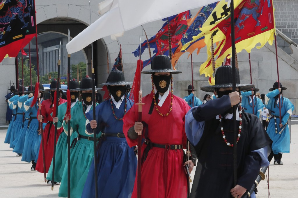 South Korean Imperial guard waring face masks move during a reenactment of the Royal Guards Changing Ceremony, which had been suspended due to the new...