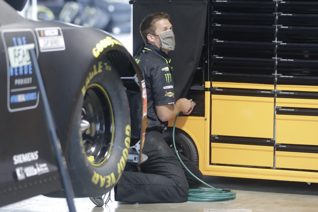 A crew member for driver Kurt Busch wears a mask as required for safety measures due to the coronavirus pandemic before the Toyota 500 NASCAR Cup Seri...