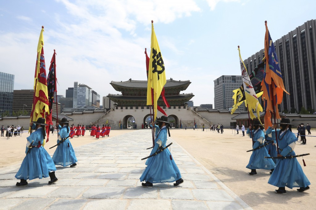 South Korean Imperial guards wearing face masks move during a reenactment of the Royal Guards Changing Ceremony, which had been suspended due to the n...