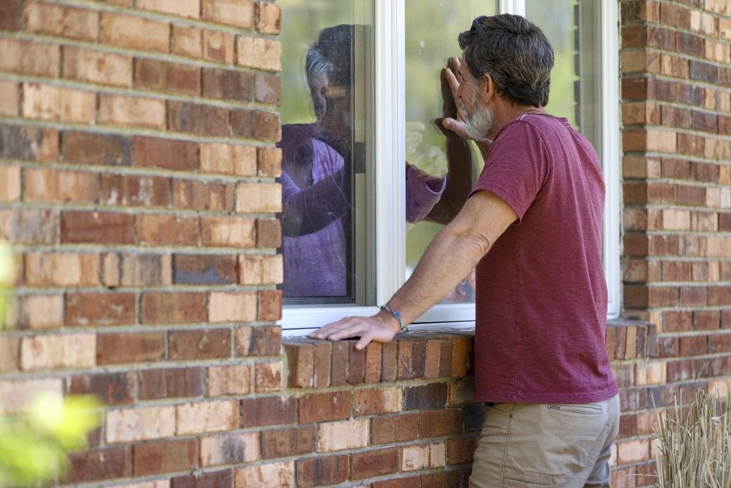 Jack Campise talks with his mother, Beverly Kearns, through her apartment window at the Kimberly Hall North nursing home, Thursday, May 14, 2020 in Wi...