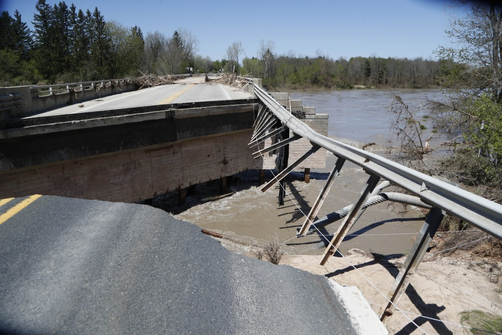 Damages are seen on one of two North M-30 bridges on Wednesday, May 20, 2020 in Edenville, Mich. After two days of heavy rain, the Edenville Dam faile...