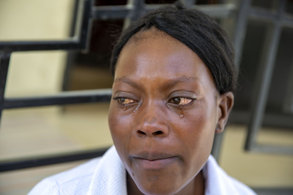 Ermilia Luberice cries during the funeral of her 7-year-old daughter Lovena Luberice at the Alcero Marc Arthur funeral home in Port-au-Prince, Haiti, ...