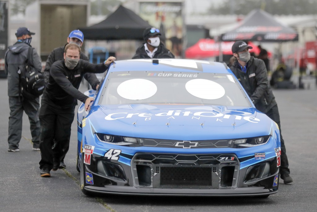 The car for driver Matt Kenseth is pushed through the infield before the Toyota 500 NASCAR Cup Series auto race Wednesday, May 20, 2020, in Darlington...