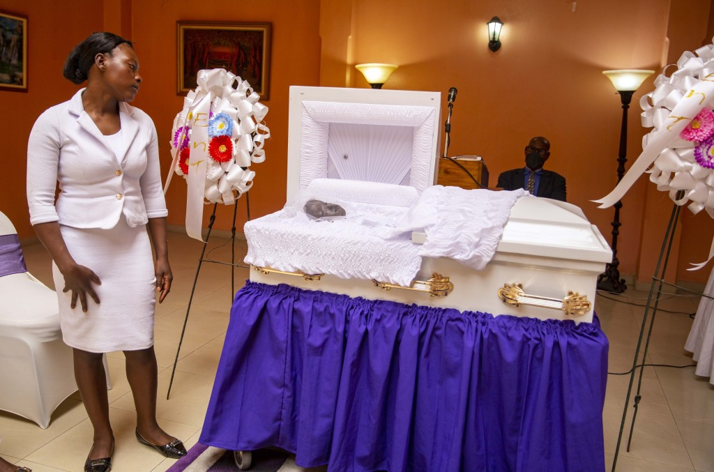 Ermilia Luberice mourns during the funeral of her 7-year-old daughter Lovena Luberice at the Alcero Marc Arthur funeral home in Port-au-Prince, Haiti,...