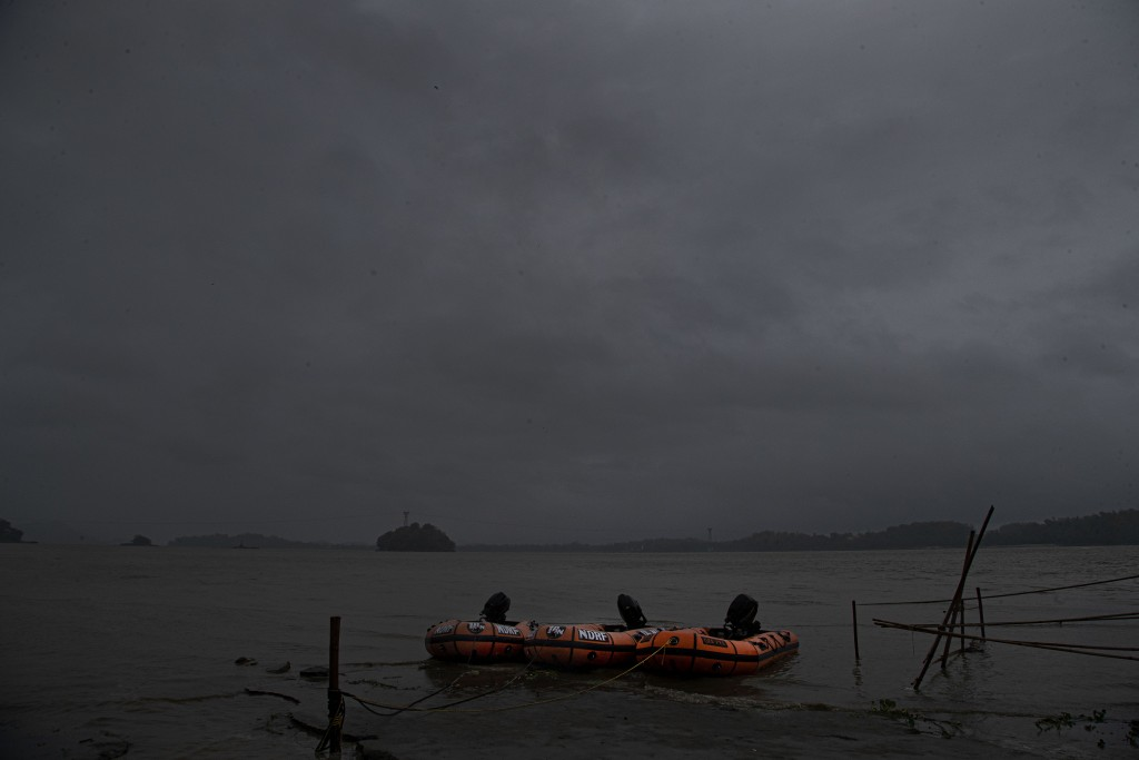 Rubber boats of National Disaster Response Force (NDRF) are kept ready for any emergency in the middle of heavy wind and rain in the river Brahmaputra...