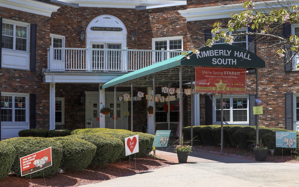 CORRECTS NAME TO TO KIMBERLY HALL SOUTH - Signs of encouragement for nursing home employees decorate the entrance to the Kimberly Hall South nursing h...