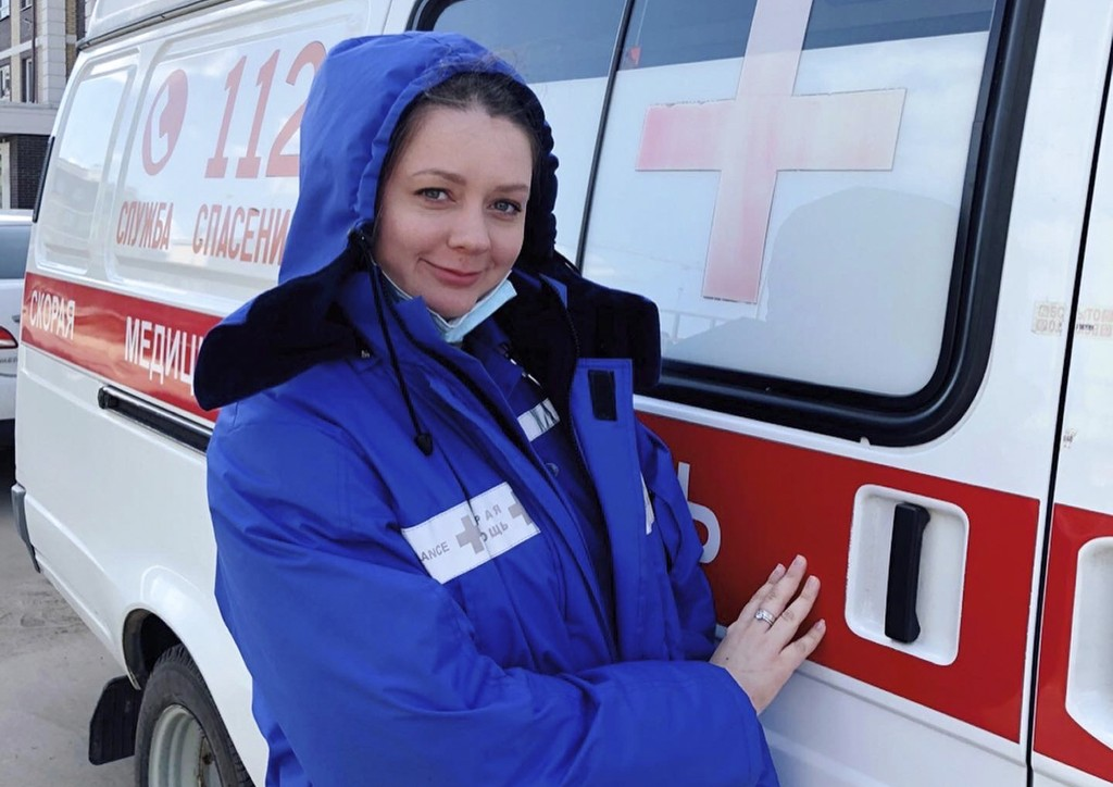 In this photo taken on March 22, 2020, Dr. Yevgeniya Bogatyryova poses for a photo next to an ambulance in Korolev, just outside Moscow, Russia. Bogat...