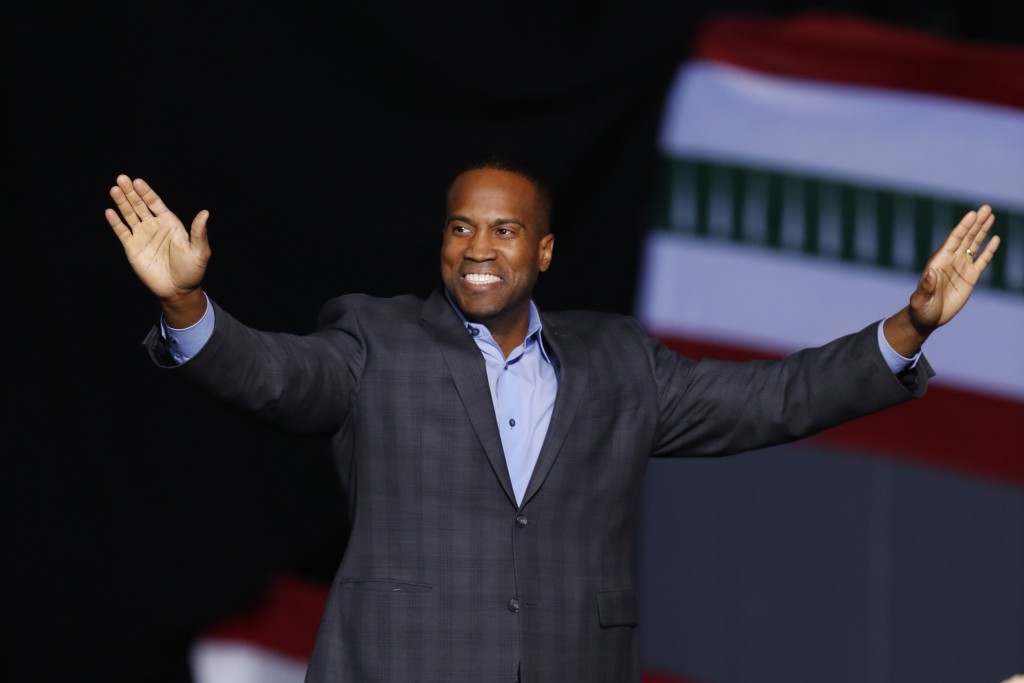 FILE - In this Dec. 18, 2019, file photo, Republican Senate candidate John James appears at a campaign rally for President Donald Trump in Battle Cree...