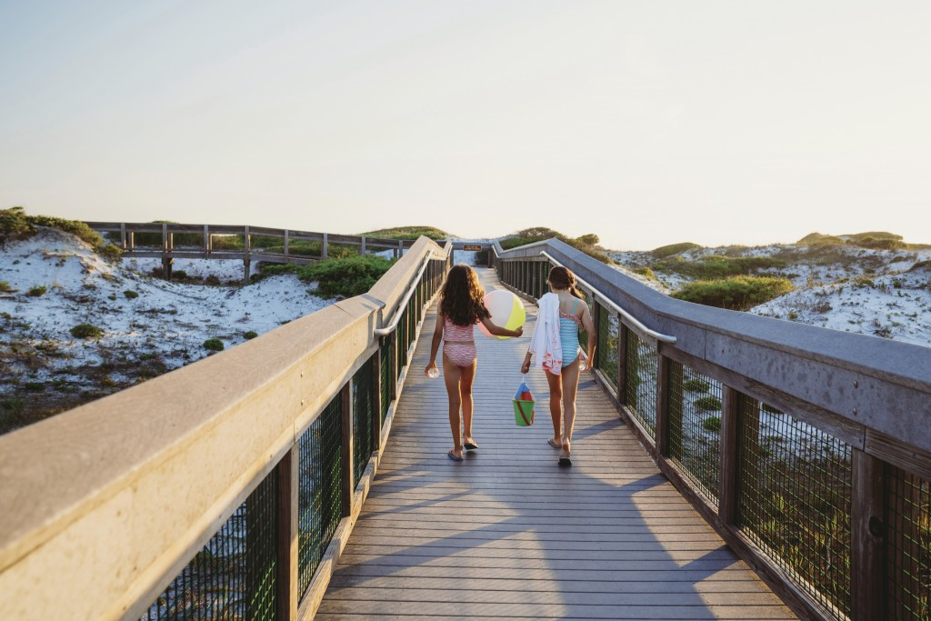 In this June 1, 2019, photo provided by the Florida Department of Environmental Protection, beachgoers walk on a boardwalk at Grayton Beach State Park...