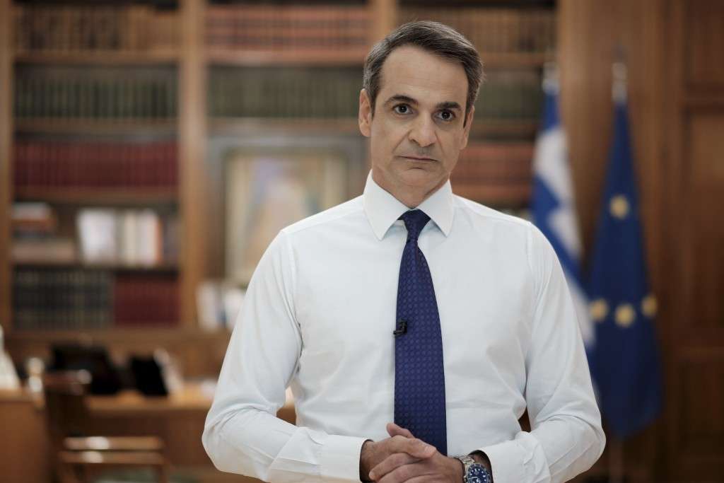 In this photo provided by the Greek Prime Minister's Office, Greece's Prime Minister Kyriakos Mitsotakis addresses the Greek nation on State TV in Ath...