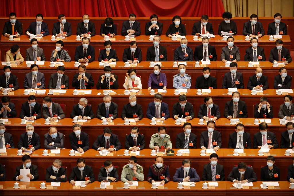 Delegates wearing face masks to protect against the spread of the new coronavirus wait for the start of the opening session of the Chinese People's Po...