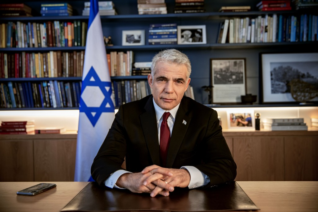 Israel's opposition leader Yair Lapid poses for a photo at his office in Tel Aviv, Israel, Thursday, May 21, 2020. (AP Photo/Oded Balilty)
