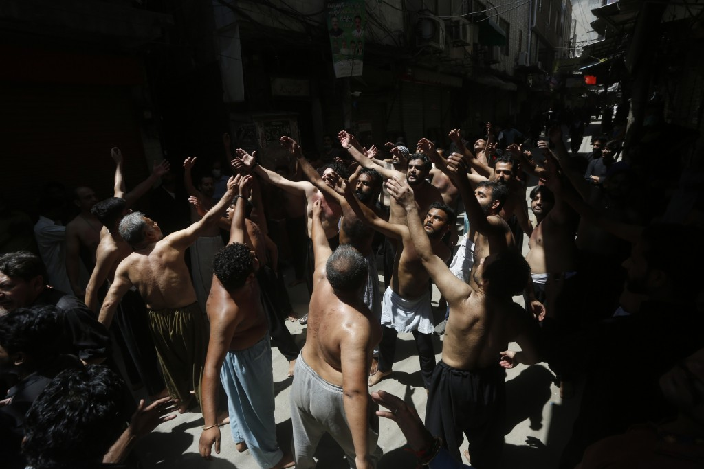 Pakistani Shiite Muslims gather to beat themselves during a procession commemorating the death anniversary of Imam Ali, the son-in-law and cousin of t...