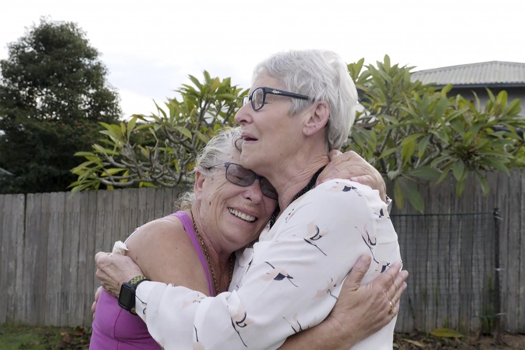 Christine Archer, right, and her sister Gail Baker cry as they are reunited in Bowraville, Australia Wednesday, May 20, 2020. Australia had rejected A...
