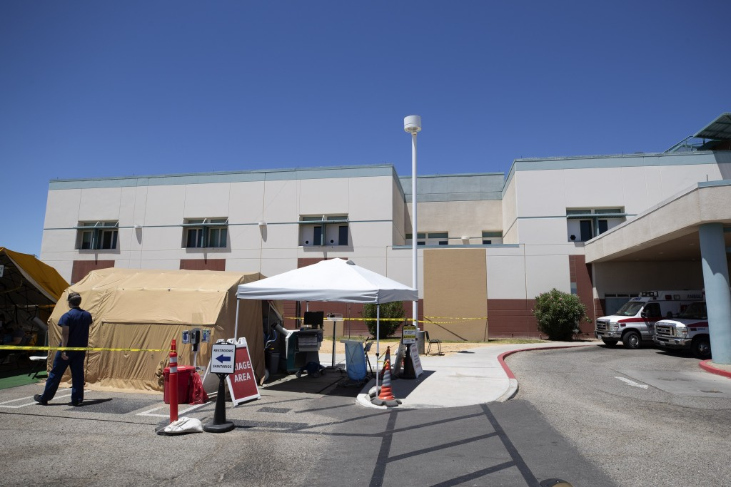 A tent sits in front of the El Centro Regional Medical Center to help process patients with symptoms related to the new coronavirus Wednesday, May 20,...