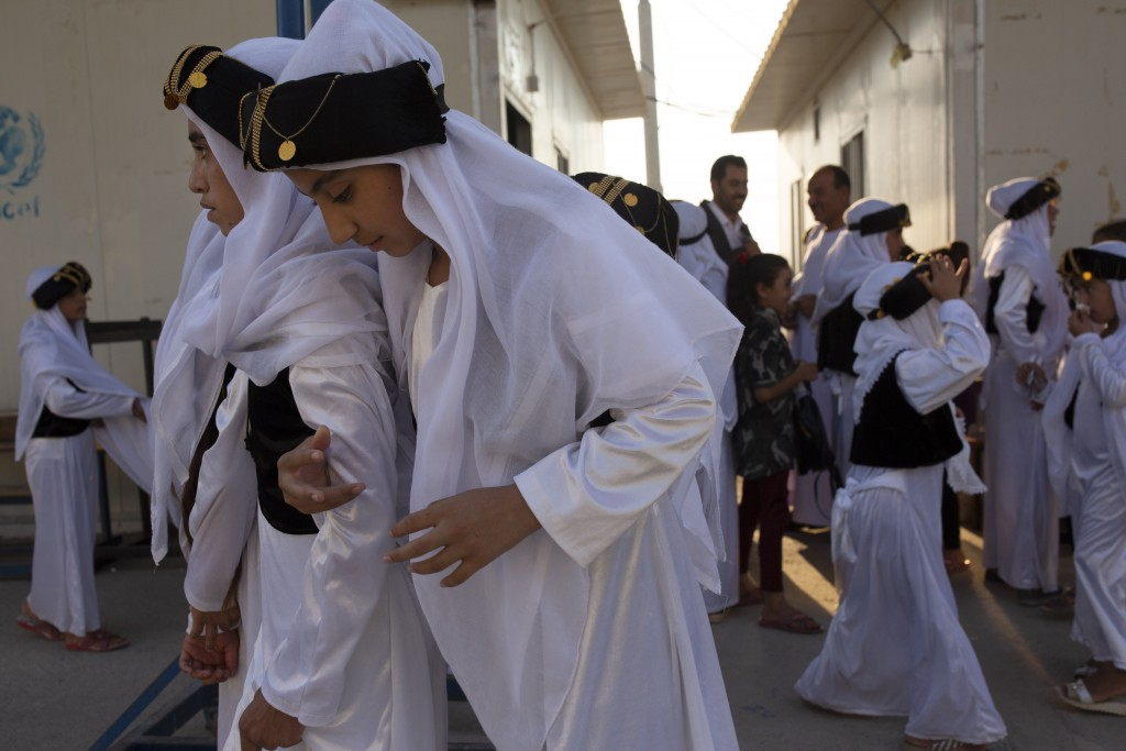 In this Sept. 14, 2019 photo, Yazidi youth, dressed in traditional clothes, take part in a program to reacquaint them with their religion and culture ...