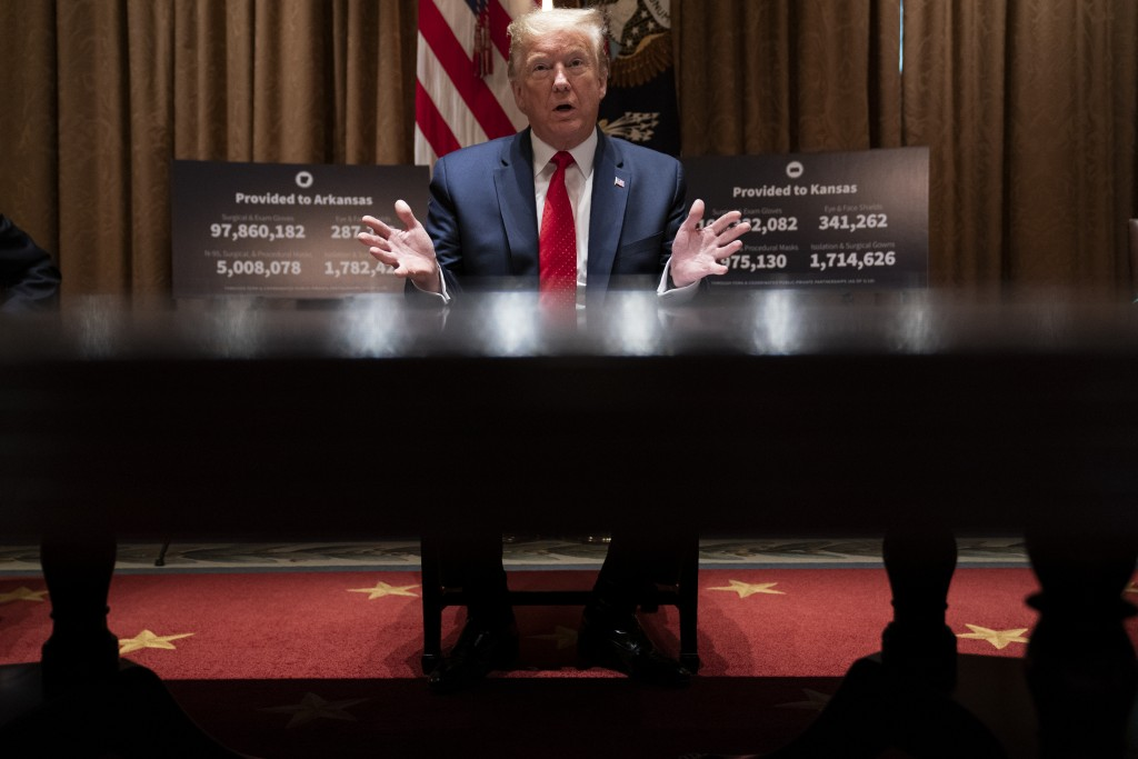 President Donald Trump speaks during a meeting with Arkansas Gov. Asa Hutchinson, and Kansas Gov. Laura Kelly, in the Cabinet Room of the White House,...