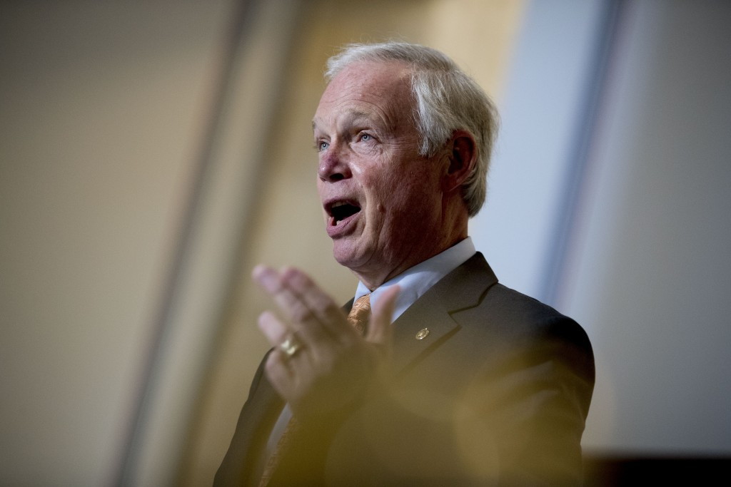 Chairman Sen. Ron Johnson, R-Wis., speaks to a reporter before the Senate Homeland Security and Governmental Affairs committee meets on Capitol Hill i...