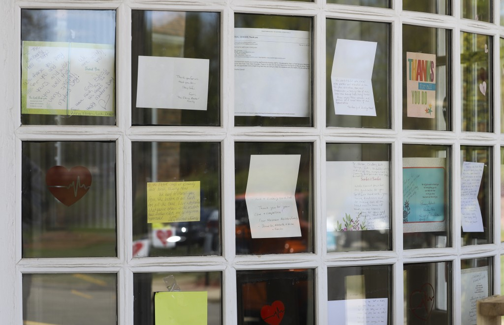 Notes for healthcare workers hang in the front window at the Kimberly Hall North nursing home, Thursday, May 14, 2020 in Windsor, Conn. The coronaviru...