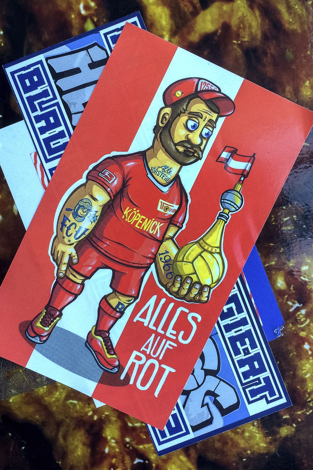 Stickers of the German first divsion, Bundesliga, soccer teams Hertha BSC Berlin and 1.FC Union Berlin are pictured in Berlin, Germany, Tuesday, March...