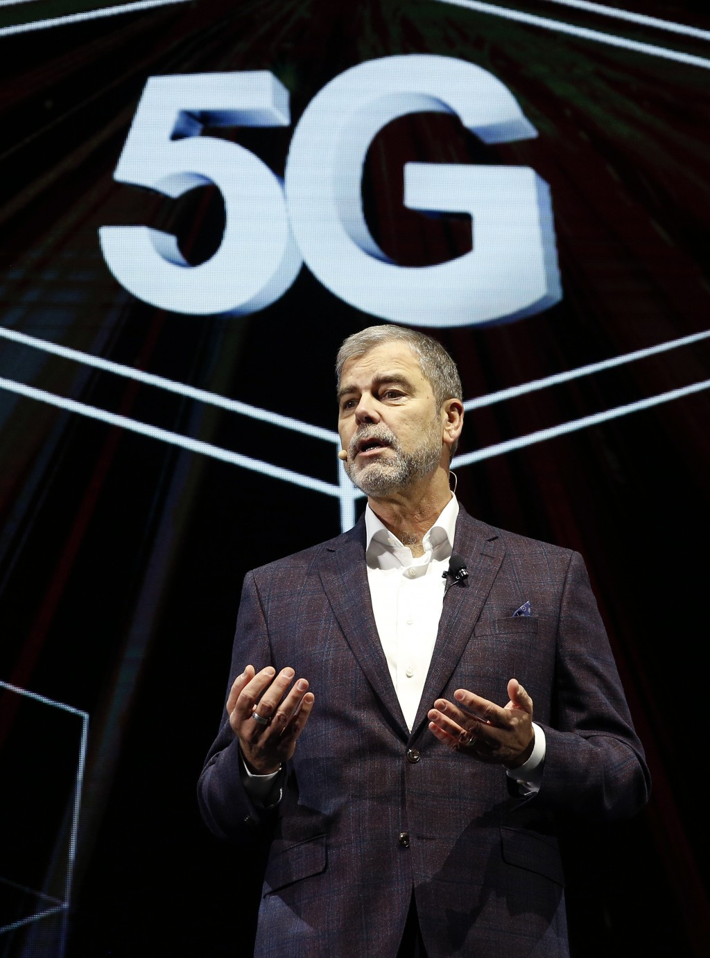 FILE - In this Jan. 7, 2019 file photo David VanderWaal, vice president of marketing for LG Electronics USA, speaks about 5G during an LG news confere...