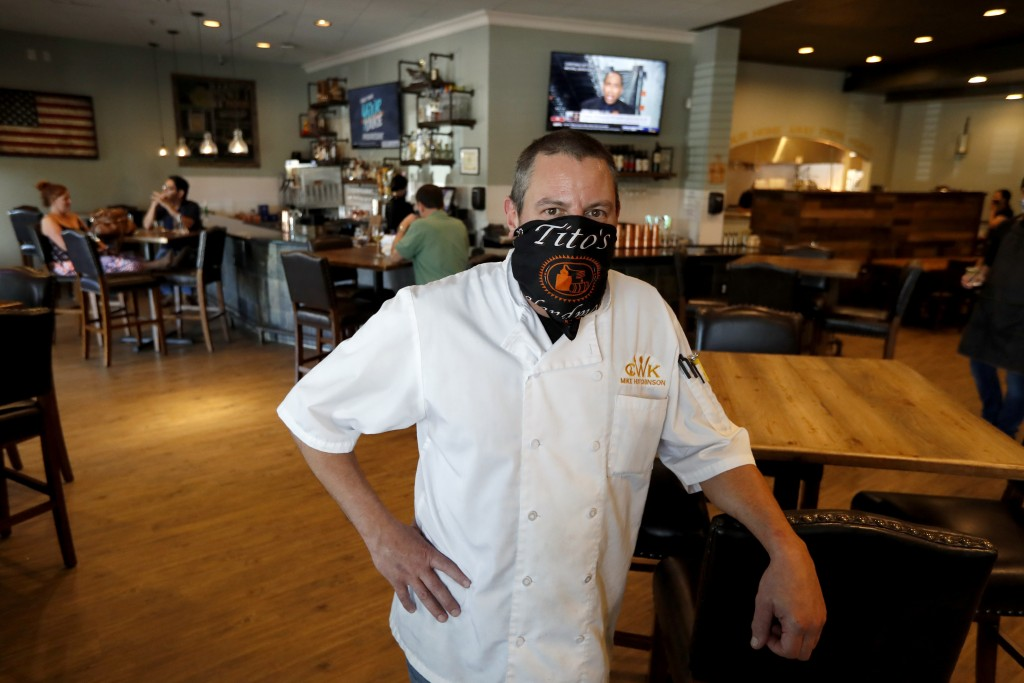 FILE - In this May 1, 2020 file photo, Mike Hutchinson, a co-owner of the CraftWay Kitchen restaurant, poses for a photo in Plano, Texas, Friday, May ...