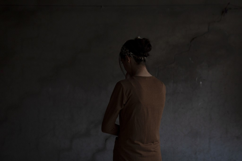 In this Nov. 14, 2019 photo, a Yazidi woman who endured five years of captivity by Islamic State militants poses for a portrait in her home in norther...