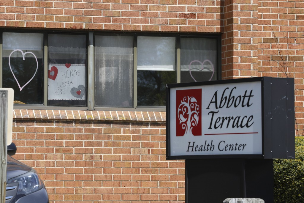 A sign for nursing home employees hangs in a window at the Abbott Terrace Health Center, Thursday, May 14, 2020 in Waterbury, Conn. The coronavirus ha...
