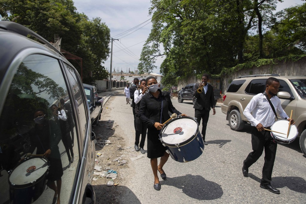 A band plays a dirge during the funeral march of 7-year-old Lovena Luberice to the Freres Public Cemetery in Port-au-Prince, Haiti, Wednesday, May 20,...