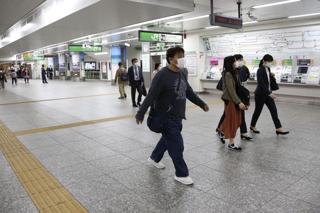 People walk at quiet Yokohama station in Yokohama, Kanagawa prefecture, near Tokyo, Thursday, May 21, 2020. Kanagawa is still under a coronavirus stat...