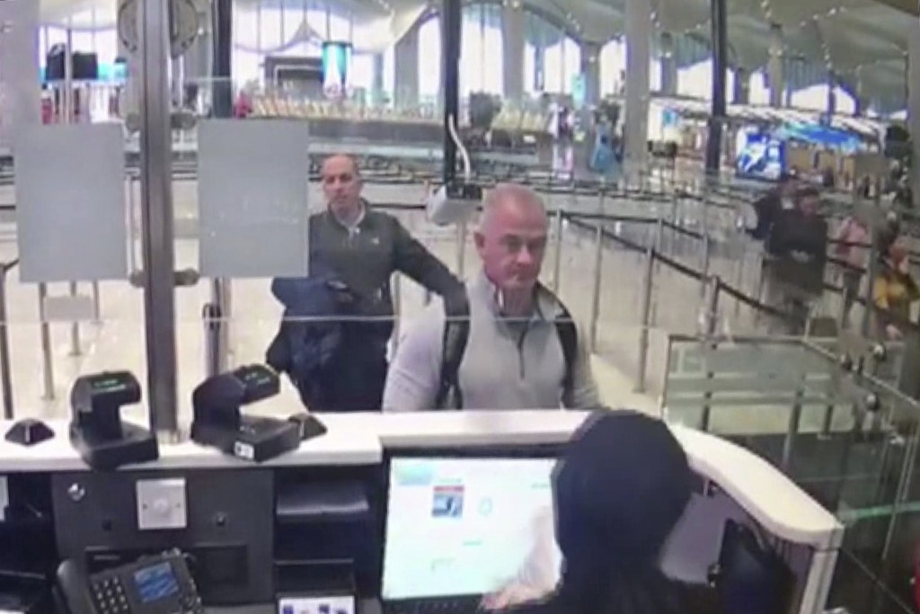 This Dec. 30, 2019 image from security camera video shows Michael L. Taylor, center, and George-Antoine Zayek at passport control at Istanbul Airport ...
