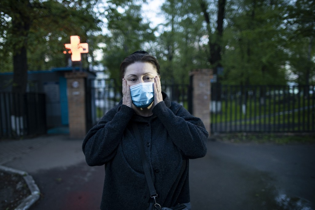 In this photo taken on Monday, May 18, 2020, Dr. Irina Vaskyanina adjusts a face mask to protect against coronavirus during her interview with the Ass...