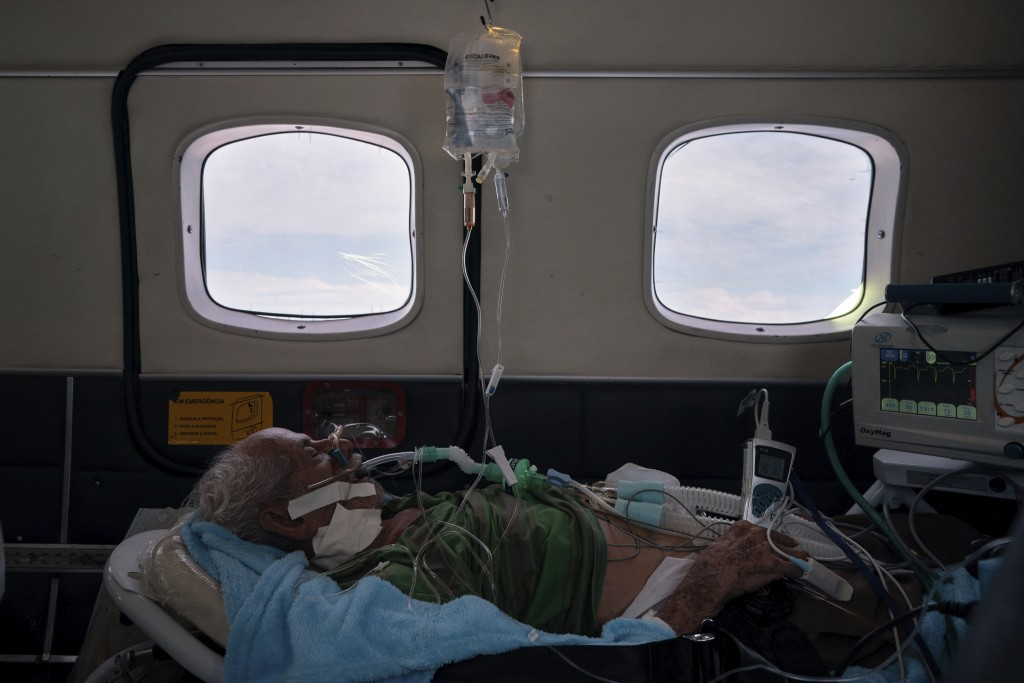 COVID-19 patient Sildomar Castelo Branco, 89, is treated onboard an aircraft as he is transferred from Santo Antônio do Iça to a hospital in Manaus in...